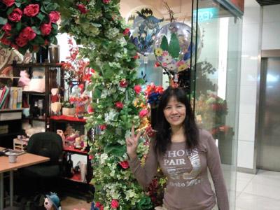 June in front of her shop at Novena